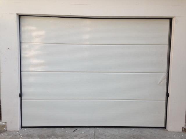 ประตูโรงจอดรถอัตโนมัติ รุ่น Wave smooth Design